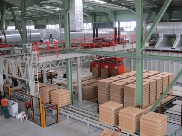 Off-loading fired material and packaging line.